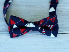 Boys Bow Tie - terrific red, blue, and white pennant banners on navy blue, bowtie for infant, toddler, child, preteen, pre-tied & adjustable