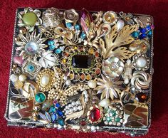 decorated cigar box with vintage and contemporary found jewelry very unique and definitely one of a kind art  box