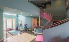 A curved staircase in muted mint green greets people to this extraordinary house 80s Interior Design, Interior Decorating, 80s Design, Modern Interior, Design Ideas, Michigan, Hidden Rooms, Villa, House Design