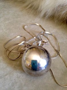 A personal favorite from my Etsy shop https://www.etsy.com/ca/listing/387409632/large-chime-ball-necklace