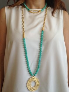 Love the long necklace with the oblong pendant.  Hmmm...I have something that just might work for this.
