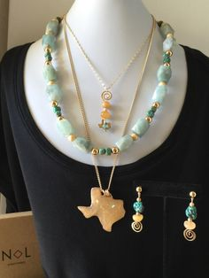 A personal favorite from my Etsy shop https://www.etsy.com/listing/492949599/texas-themed-layered-necklace-earrings