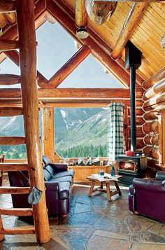 Inspiring Small Log Cabin Designs Oversized, double-paned windows usher a tremendous amount of light into the cabin and offer clear views of the breathtaking landscape.