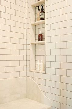 Love the idea of shower niches recessed between the studs in the shower wall.