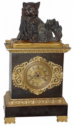 French gilt and patinated bronze 8 days, time and strike, mantel clock, with a bronze figure of a grooming cat sitting on a pillow, the cat with nodding head, c1830