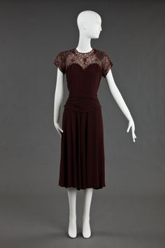 Dress, 1940 Brown crepe and lace dress with copper beads on bodice Source: collection.goldstein.design.umn.edu