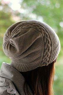 A traveling cable gracefully swoops over the crown of this perfectly slouchy hat, meant for those chilly autumn and cold winter days. Knitted up in either a lace weight yarn held doubled or fingering weight held single, this hat is light and portable yet warm and cozy! Match with the Traveller's Mitts to keep yourself traveling in style!