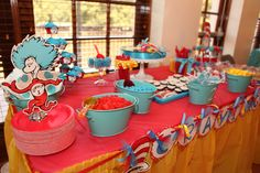 """We did a DESSERT table.  The banner read """"CRAVINGS"""" and was bought on Etsy.com.  I got glass jars for the candy bar at the Dollar Tree...>CHEAP and added ribbon to some and even glued candle sticks so a few to vary the heights.  Use Epoxy glue.  Candy was purchased at Party City ...not cheap...but the right colors and easy!"""