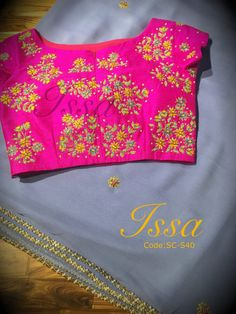 SC40: Bluish grey chiffon with hot pink hand embroidered blouse.To order please call/ WhatsApp on 9949944178 or mail us @issadesignerstudio@gmail.com