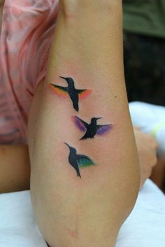 A nice idea for a Sisters tattoo!! Each bird would be my sisters favorite color.. A side/rib placement would be best in my opinion! :)