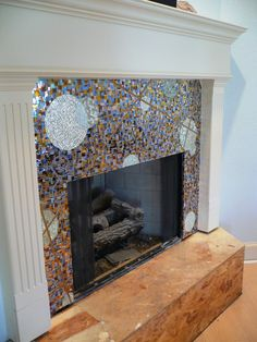 mosaic fireplace surround made with glass tiles wall. Black Bedroom Furniture Sets. Home Design Ideas
