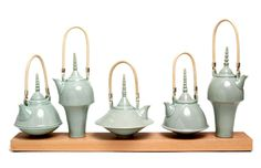 Very modern looking teapots by Melanie Brown. They look like they could be from a fairytale illustration.
