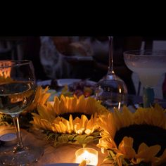 I made a simple summer centerpiece by cutting the stems off of sunflowers and placing tea lights in the center of the flower.  It was great for setting the mood at a late night, outdoor, dinner party!
