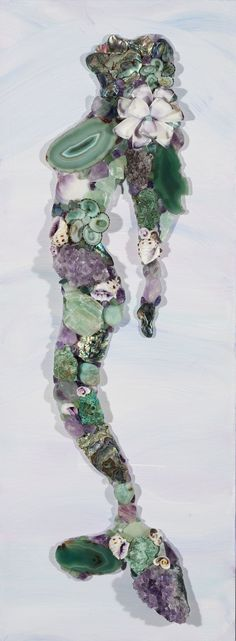Each one of our gemstone Mosaic Mermaids is a unique one of a kind piece.  By ordering an Amethyst-Seafoam Mermaid  you will receive one in similar shades of Violet/Seafoam and created with the same materials which include amethyst clusters, crystals & stones, lepidite, amazonite, calcite, fushit...