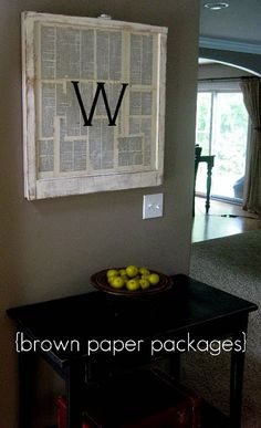 Made from an old window, and dictionary pages...