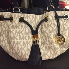 Michael Kors Jet Set Gathered Tote, White & Navy White and Navy signature logo MK gathered tote. Navy leather tassel accessory front, gold detail grommets and gold MK keyfob. Michael Kors Bags Totes