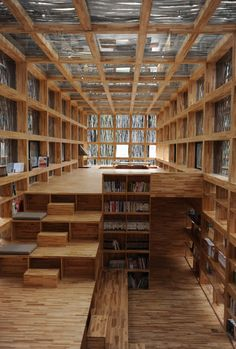 This beautiful library by Li Xiaodong Atelier is nestled in the small village of Huairou in China. Its interior features plenty of cozy nooks and crannies to read in and great care was taken with the exterior to make sure that it would blend with its natural surroundings.