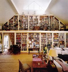 Two story home libraries are so amazing