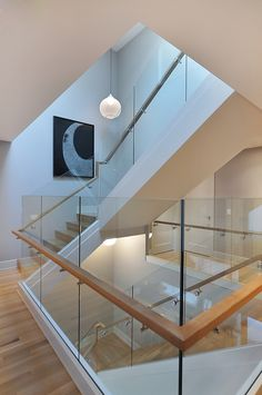 """Glass Stair Railing by Johnson & Associates Interior Design Living Spaces Art work: """"Absolute Catharsis I"""" by Mario Trejo, Herringer Kiss Gallery"""