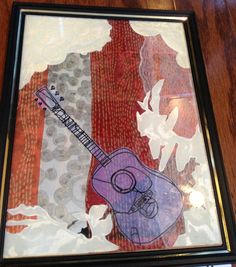 Guitar- mixed media collage from 100% recycled materials. $30.00, via Etsy.