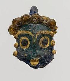 Phoenician head pendants page 3