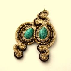 beige earrings with turquoise stone