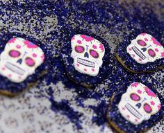 Sugar Skull Cookies from Porto's Bakery - Made with Black and Purple Edible Glitter Bakery Bling Sprinkles from Little Waisted. Bakery Bling by Little Waisted - Edible Glitter Sugar Sprinkle Mixes. Sold at select Michael's Stores and online at Amazon, Etsy and littlewaisted.com. Check out all of our edible glitter sugar & salt products - sprinkles, cocktail rims & liquor coming soon!