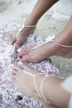 brilliant idea! instead of shoes, everyone will be barefoot. girls will wear this kind of ankle jewelry and the men will sport bare feet! Would be so cute for a beach wedding!
