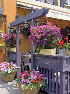 Example of how you can use wooden structures outside of your home to create a place to hang flowers.