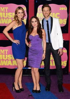 Cherill Green, Hannah Blaylock and Dean Berner of Edens Edge arrive at the CMT Music Awards. See more of your favorite country crooners on Wonderwall! http://on-msn.com/LBMgTg