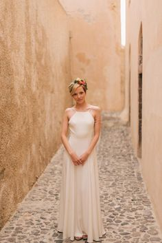 Molly & David's stylish elopement in Santorini, Greece in a bohemian and modern style! Planned & designed by Tie the Knot in Santorini.