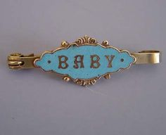 """VICTORIAN """"Baby"""" pin in gold tone with blue enamel, 1-3/4""""."""