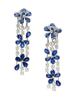 A Pair of 18 Karat White Gold, Sapphire and Diamond Fil de l'Eau Earclips, Van Cleef & Arpels, Circa 2009,  in a stylized floral motif, composed of cluster tops supporting triple strand drops, containing 30 pear shape sapphires in blue hues of various tones weighing approximately 13.20 carats total, and 38 round brilliant cut diamonds weighing approximately 3.89 carats total.  Stamp: VCA OR 750 BL 260564 (French assay marks) (maker's mark). - See more at…
