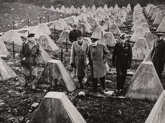 Winston Churchill walks among the dragons teeth (tank traps) of the fallen Siegfried Line. With him are British Field Marshal Montgomery, British Field Marshal Sir Alan Brooke, and U.S. General William H. Simpson. March 1944.