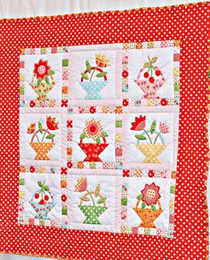 Flower Basket appliqued quilt with updated cheery interpretation. I like!