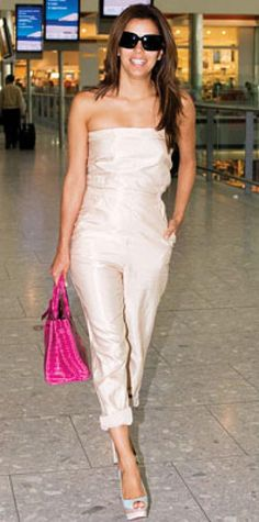 Look of the Day › May 17, 2009 Parker strolled through the Nice airport wearing a strapless jumpsuit accessorized with an Hermes bag and three-tone slingbacks from Christian Louboutin.