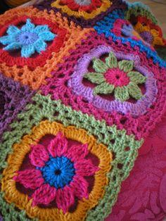 Pretty granny square blanket.