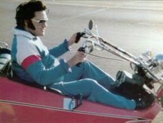 Elvis riding his Rupp Centaur Trike, September, 1975.