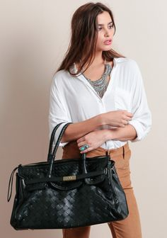 This spacious bag is Completed with a top zipper closure and buckle accent at the front.