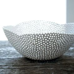 This porcelain bowl has hand drilled holes that remind me of coral. $185 ~ Oh my, this is the end all bowl . . .