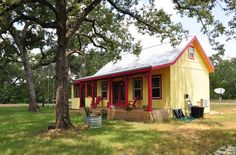 This 16x26 country cabin was built for a client by Kanga Room Systems in Texas. This little cabin offers about 416 sq. ft. of space without including the upstairs sleeping loft. As soon as you appr...