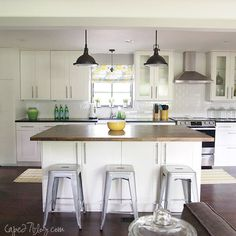 soapstone countertops, butcher block island, subway tiles, industrial vibe --- so much to like