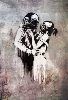 Couple with vintage diving helmets hugging art