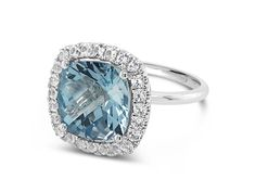 Blue topaz cocktail ring surrounded by a halo of 24 white sapphires White Sapphire, Blue Topaz, Cushion Cut, Cocktail Rings, Halo, Studs, Barcelona, Cocktails, White Gold