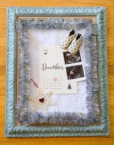 Pregnancy announcement with sonogram for December baby with a snowflake ornament, hand painted vintage frame, and baby shoes (credit: Casey Austin Photography)