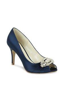 5229050b3bda A crystal detail at the toe gives these stunning satin peep toe heels a  dazzling touch. David s Bridal