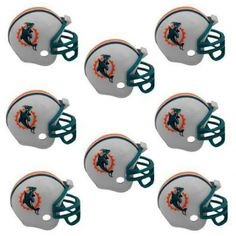 Miami Dolphins NFL Helmet Party Kit www.teeliesfairygarden.com Let your fairies enjoy a football game with this helmet party kit! This set includes 16 helmets of the Miami Dolphins enough for all of your fairies and gnomes. #fairyhelmets