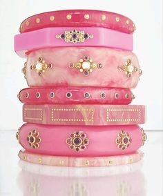 Assortment of pretty pink bangles. Love these!