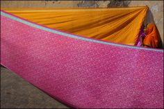 A pilgrim from Maharashtra drying Saris on the Ghats in Dwarka. Gujarat