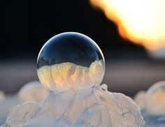 """Photographer Angela Kelly took her son outside in frigid temperatures to blow bubbles and shoot some amazing pictures, which she titled as """"Frozen in a Bubble""""..."""